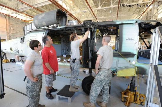 A CCAD artisan trains U.S. Army Soldiers on CCAD s first UH-60L to L recap.