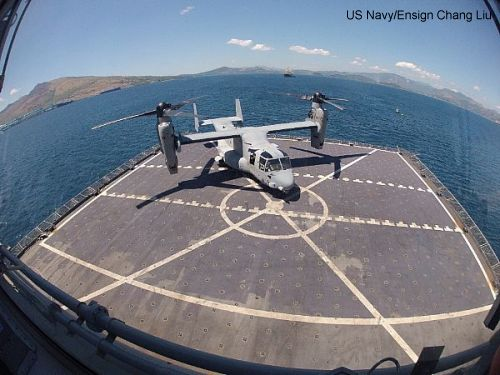 Navy Dry Cargo Ship Conducts Flight Operations with MV-22 Marine Osprey