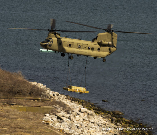 A CH-47 Chinook helicopter delivers a load of lumber to Great Gull Island, a 17-acre island in the Long Island Sound. The lumber was one of three deliveries made by Detachment 1, Company B, 2/104th Aviation from Groton to the island on April 25. More than 40 thousand pounds of lumber and supplies were airlifted to the island as part of an inter-agency environmental program with the American Museum of Natural History and the U.S. Fish and Wildlife Service.