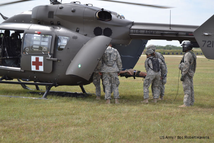 Members of 1077th Ground Ambulance Company, Kansas Army National Guard , Olathe KS, load a patient into a Lakota helicopter from D Company, 1st Battalion, 376th Aviation Regiment, Nebraska National Guard, Grand Island NB, as part of a large-scale, natural disaster exercise, Vigilant Guard 2014 hosted by the Kansas National Guard, at Crisis City, Salina, Kansas, Aug. 4-7, 2014