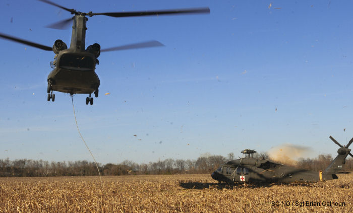 South Carolina Army National Guard Chinook helicopter recovered an UH-60 Black Hawk that made an emergency landing in an open field Dec. 3 due to a main rotor blade malfunction in Columbia, SC