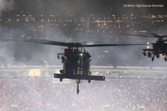 AH-64s and UH-60s from 101st Combat Aviation Brigade, 101st Airborne Division (Air Assault), approach Met Life Stadium as fireworks go off just prior to flying over the stadium in East Rutherford, N.J., Feb. 2, 2014