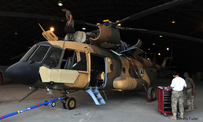 A team of aircraft maintenance technicians from the Afghan Special Missions Wing perform periodic repair functions on the Wing s Mi-17 helicopters in a maintenance facility at Kabul Hamid Karzia International Airport in order to sustain their aircraft.