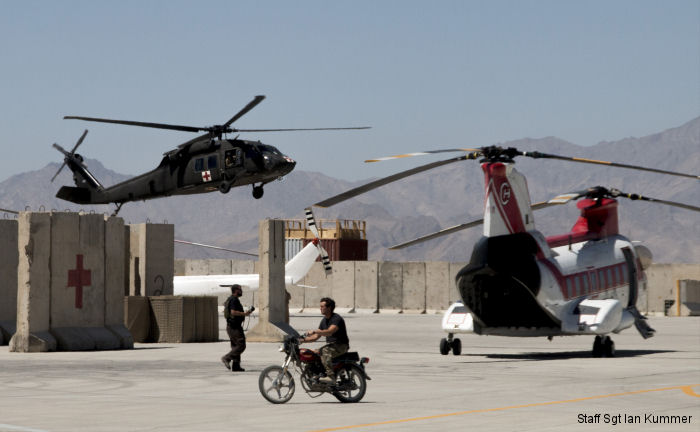 40th CAB HH-60M lands on FOB Dahlke, Afghanistan along side a <a href=/database/org/us_columbia_helicopters_international/>Columbia Helicopters</a> BV-107