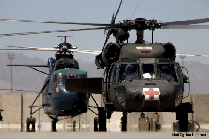 Black Hawk. Civilian contracted <a href=/database/model/1245/>S-61T Triton</a> on background