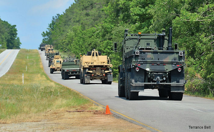 A convoy of driverless Army trucks makes its way through the Department of Energy s Savannah River Site in South Carolina, May 29, 2014.