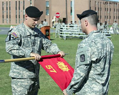 First Sgt. Michael Ostrander, left, senior adviser of 57th Transportation Company, and Capt. Rodney Landrum, commander, case the guidon during an inactivation ceremony at 548th Sustainment Support Battalions parade field Friday. Photo by Sgt. Crain Jared.