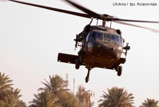 An Army Black Hawk helicopter deployed to Iraq with the Enhanced Combat Aviation Brigade, 1st Infantry Division takes off from a pad near Baghdad, Jan.12 2011