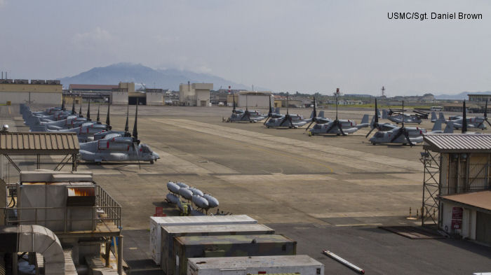 Twelve MV-22 Ospreys sit parked on the tarmac at Marine Corps Air Station Iwakuni here July 24, 2012, after being offloaded from the civilian freight ship, Green Ridge. This marks the first MV-22 Osprey aircraft deployment to Japan.