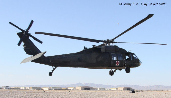 A UH-60 Black Hawk helicopter lifts off the airfield at Shindand Air Base, Afghanistan, Dec. 7, 2013. This particular Black Hawk is one of eight that provide medical evacuations. The 1st Bn., 168th Av. Regt., is responsible throughout the Regional Command (West) area of operations.