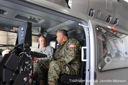 Chief Warrant Officer Braden Briggs, UH-72 Lakota pilot, 36th Combat Aviation Brigade, briefs a Chilean army officer on operating the UH-72 Lakota helicopter.