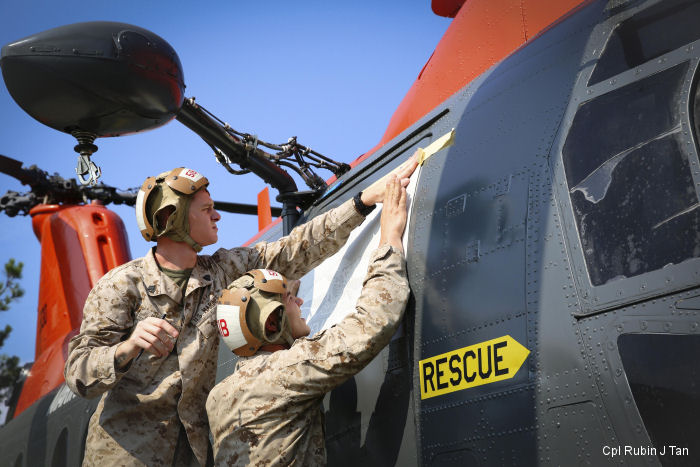 In honor of Hospitalman 1st Class Kevin Frank, Marines with Marine Aviation Logistics Squadron 31 corossion control, assisted in the rededication of MCAS Beaufort's display CH-46 Sea Knight