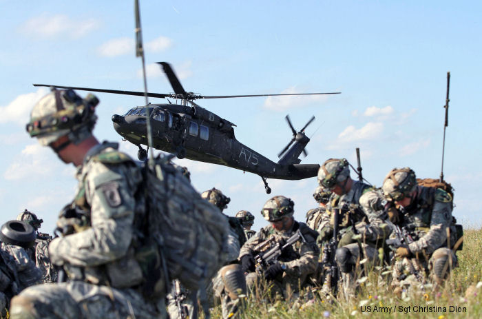173rd Airborne Brigade paratroopers air assault through mock village during Saber Junction 14