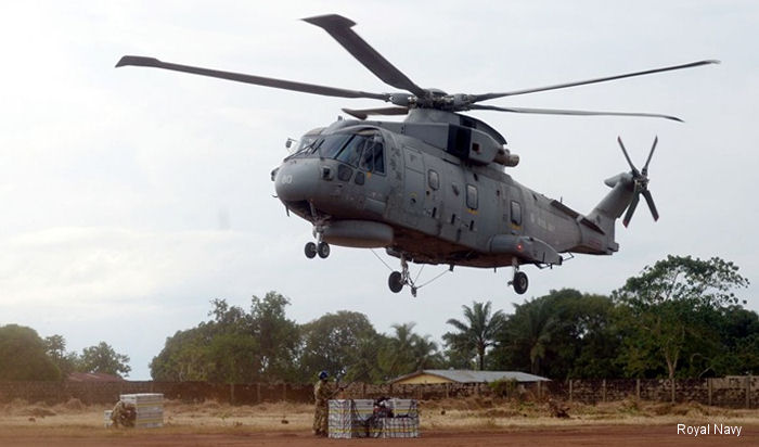 Royal Navy Merlin helicopters based aboard RFA Argus in Freetown Sierra Leone deliver aid under UN World Food Programme in the ongoing international effort against Ebola