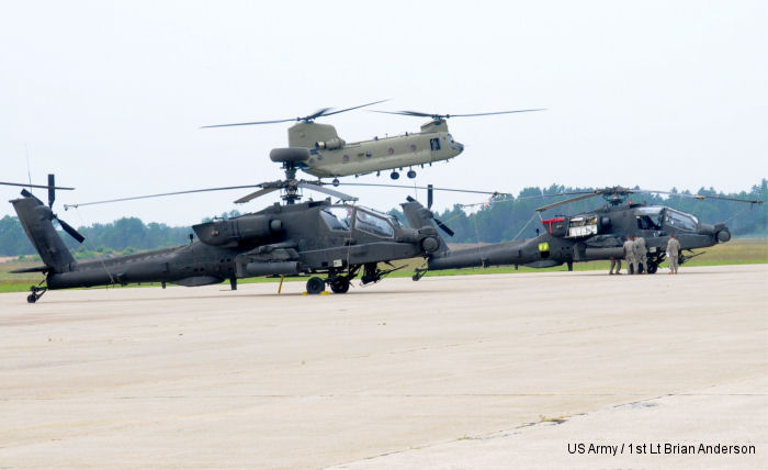 1-104th Attack Reconnaissance Battalion AH-64 Apache after a live-fire exercise at the Grayling Air Gunnery Range during Operation Northern Strike 2014. <br> A CH-47 Chinook lands in the background.