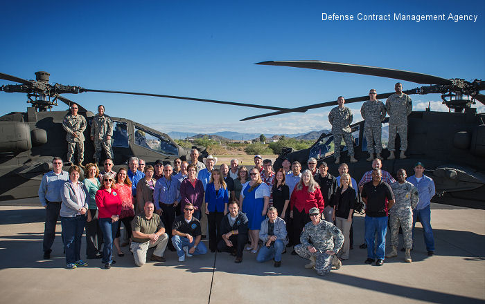 The Defense Contract Management Agency Boeing Mesa team honors the delivery of the last AH-64D Apache Longbow Block II helicopter with a picture of the last AH-64D (right) and <a href=/database/model/1241/>the new AH-64E</a>