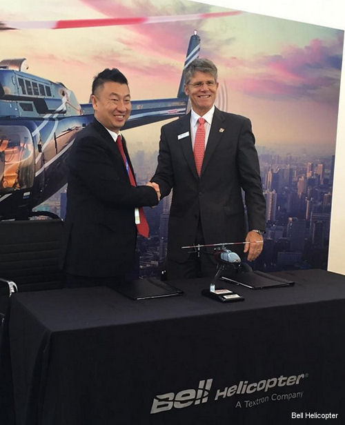 Left to Right: Zheng Gang, chairman of Reignwood Aviation and John Garrison, president and CEO, Bell Helicopter