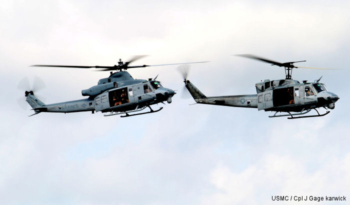 UH-1N Huey (Right) and UH-1Y Venom (Left) during the final flight of the UH-1N Huey for HMLA-773,  New Orléans NAS JRB, Aug 28, 2014