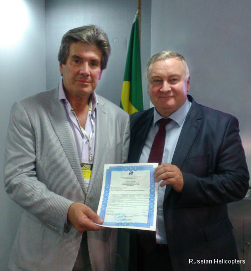 Sergei Ostapenko,<br> Russian Helicopters sales director for commercial helicopters (on the right), and Helipark's President João Velloso.