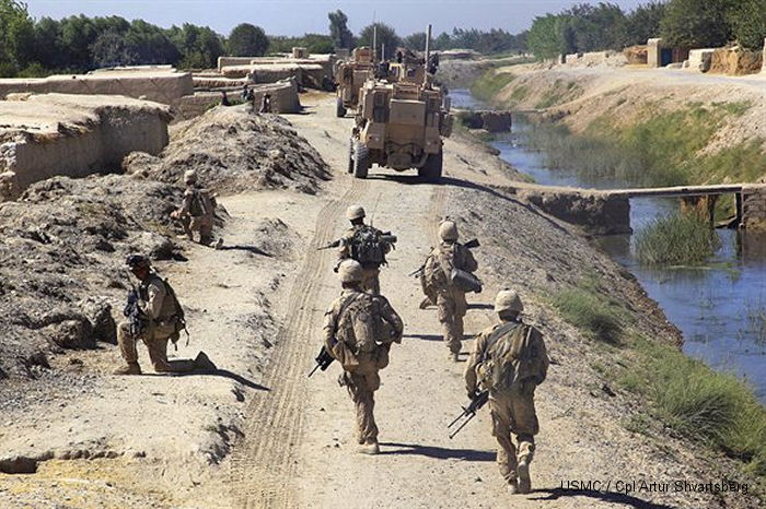 Bravo Company, 1st Battalion, 5th Marine Regiment conducts security patrol in Nawa district, Helmand province,  Aug. 7, 2009