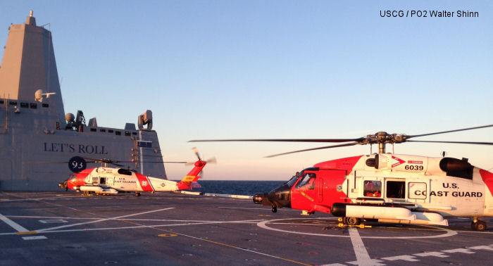 Coast Guard helicopters train aboard the Navy newest warship