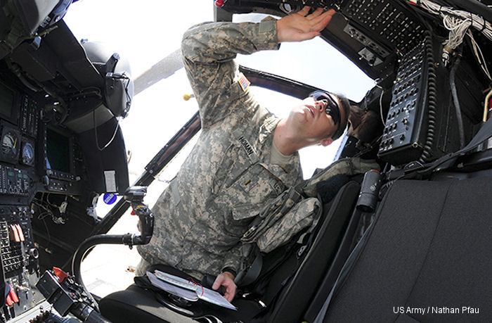Second Lt Larry Homan, OH-58D student pilot, performs preflight checks before taking the helm of an OH-58D Kiowa Warrior at Hanchey Army Heliport, Aug. 18, 2014, at Fort Rucker, Alabama. Homan is part of the last OH-58D class at Fort Rucker.