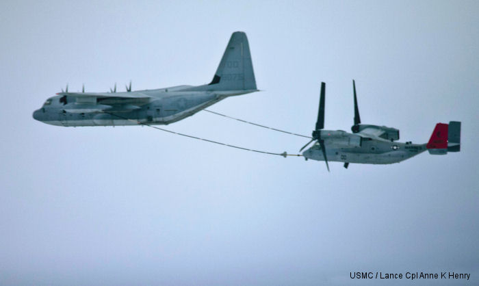 An MV-22B Osprey from <a href=/database/sqd/1232/>VMM-265</a> receives fuel from a KC-130J Super Hercules refueling aircraft during training.