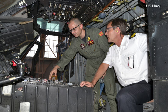 Lt Cmdr Pablo Mendez, a Spanish navy foreign exchange student assigned to Helicopter Maritime Strike Squadron 40 ( <a href=http://www.helis.com/database/sqd/743/>HSM-40</a> ), left, discusses the flight control console of the <a href=/database/model/268/>SH-60F Seahawk</a> helicopter with Spanish Navy Cmdr. Alberto Gonzalez-Cela during a tour of the aircraft at Fleet Readiness Center Southeast (FRCSE) May 13. The Spanish navy is purchasing two helicopters through the Foreign Military Sales program once artisans at FRCSE complete overhauls on the aircraft.