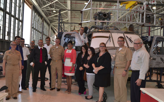 Representatives from Naval Air Systems Command Program Manager Air 299 and Spanish naval officers gather in front of a SH-60F Seahawk helicopter being overhauled at Fleet Readiness Center Southeast May 13. The Spanish navy is purchasing two Seahawk helicopters through the U.S. Foreign Military Sales Program. The helicopters arrived at FRCSE in April from the military aircraft boneyard at Davis-Monthan Air Force Base in Arizona