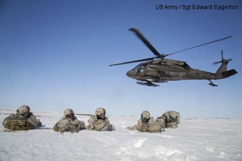 Paratroopers from the 6th Engineer Battalion (Combat Airborne), 2nd Engineer Brigade, U.S. Army, pull security after exiting a UH-60 Black Hawk helicopter from 1-207th Aviation Regiment, Alaska Army National Guard, during exercise Arctic Pegasus near Deadhorse, Alaska, May 1, 2014. Arctic Pegasus is a multi-component, joint exercise that will further refine planning and mission capabilities between U.S. Army Alaska, the U.S. Air Force, the Alaska National Guard, and the state of Alaska.