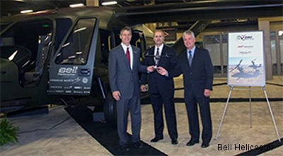 Bell Helicopter President and CEO John Garrison presents Meggitt's Kevin Shaffer, Global Director of Sales & Marketing, and John Mlincsek, Vice President of Business Development, with a Bell V-280 model at the 2014 Army Aviation Mission Solutions Summit in Nashville, TN.