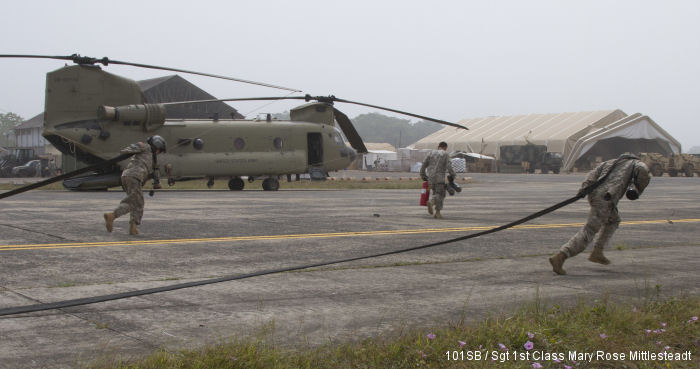 Under Operation United Assistance in Liberia the US Army 101st Sustainment Brigade, Task Force Lifeliners, train in remote fueling mission with Chinook helicopter from 2-501st AVN