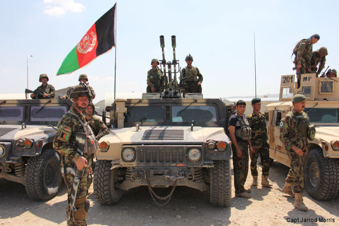 Afghan National Army soldiers from 201 Corps prepare to move out at Tactical Base Gamberi