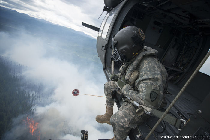Alaska Army National Guard UH-60 Black Hawk helicopters from the 1st Battalion, 207th Aviation Regiment, continue to conduct water bucket drops in support of wildfire suppression efforts