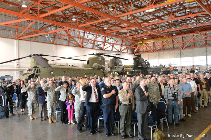Attendees at an unveiling ceremony for the the California National Guard s new CH-47F Chinook helicopters stand for the national anthem in Stockton on Feb. 9.