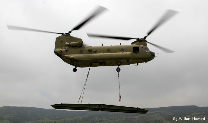 A CH-47F Chinook from 2nd General Support Aviation Battalion (GSAB), 4th Combat Aviation Brigade (CAB) sling load a Rapidly Emplaced Bridge System (REBS) to gap a crossing at Fort Carson