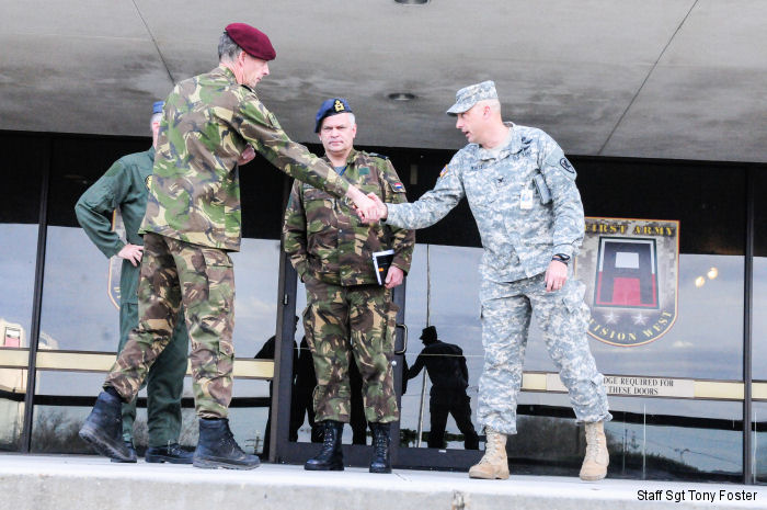 Col. John White, right, US 21st Cavalry Brigade commander, shakes hands with Dutch Brig. Gen. C.J. (Kees) Matthijssen, left, 11th Airmobile Brigade commander, and Air Commodore Jan Willem Westerbeek, center, Dutch Defense Helicopter Command on Fort Hood, Texas, January 29