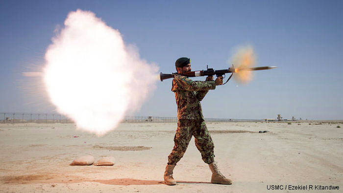 Afghan soldier launchs a Soviet/Russian made rocket-propelled grenade RPG-7 during training