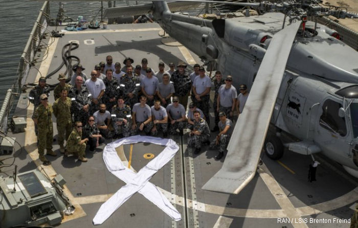 Royal Australian Navy HMAS Newcastle in the Persian Gulf in support of Operation MANITOU show their support for the White Ribbon campaign, national male-led campaign to end violence against women