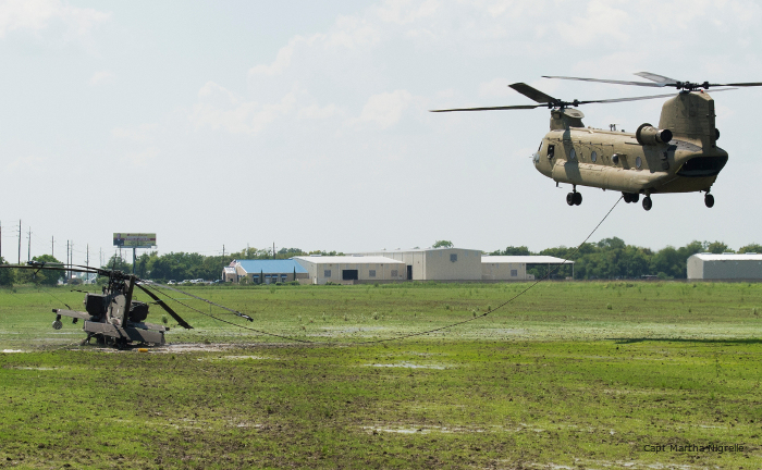 Texas Army National Guard, 1-149 ARB, 36th CAB AH-64D Apache was sling load by Chinook following a precautionary landing due to mechanical issues.