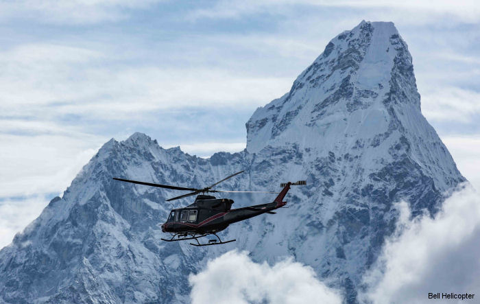 A Bell 412EPI, on a tour throughout Nepal, successfully demonstrated landing and take offs from 15200 f (4633 m) and flew up to 20000 f ( 6097 m) near Mount Everest with five passengers onboard