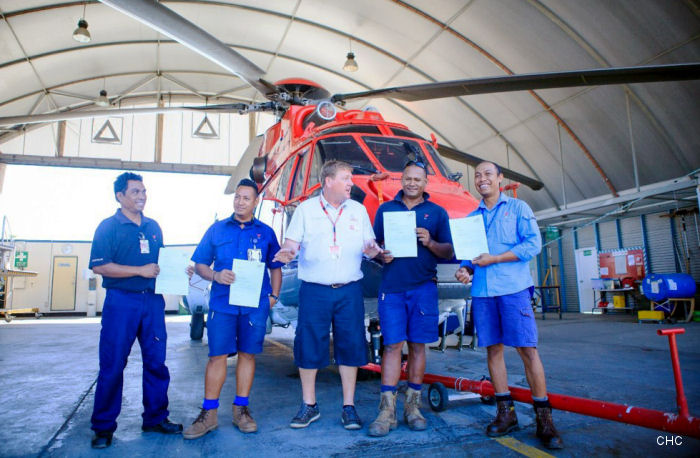 Martinho Ferreira, Tito Exposto, John Biggs - TAFESA, Elvis Soares, Atoy Jonando  in the hangar at Dili Airport