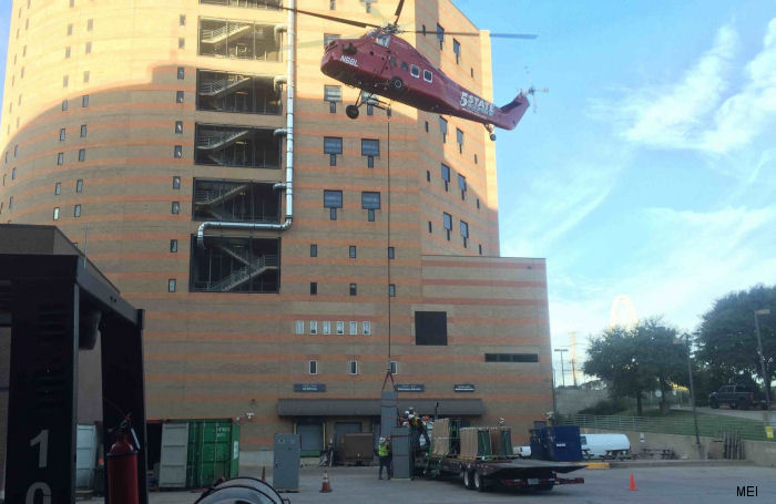 A 5 State Helicopters Inc' S-58ET helicopter helped in the installation of data equipment at the Lew Sterrett Justice Center in  Dallas, Texas