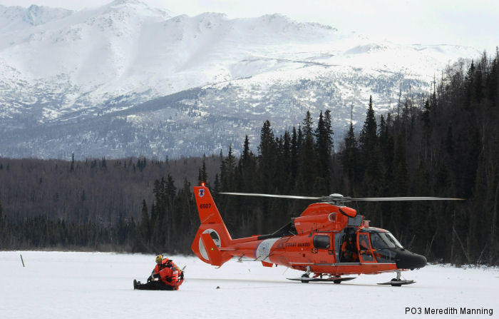 USCG Kodiak, Sector Anchorage and the National Ice Rescue School in Essexville, Michigan perform ice rescues from MH-60 Jayhawk and MH-65 Dolphin on Joint Base Elmendorf-Richardson, Alaska