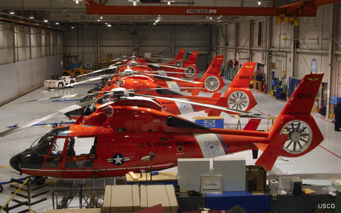 All five Coast Guard Air Station Traverse City MH-65 Dolphin helicopters in the hangar in Northern Michigan