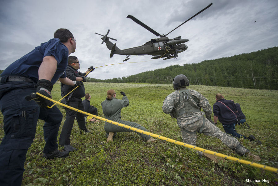 Emergency services personnel from the city of Fairbanks, Alaska, train together with military personnel from Fort Wainwright