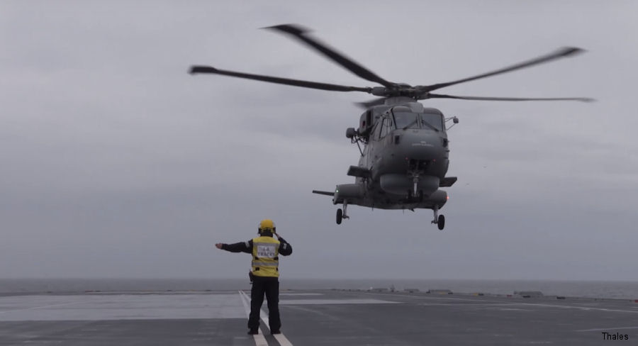 A Merlin helicopter from 820 Naval Air Squadron has become the first aircraft to ever land on HMS Queen Elizabeth, the Royal Navy's biggest warship