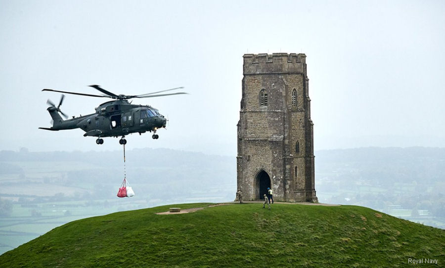 Royal Navy' 846 Naval Air Squadron provided Merlin helicopter to help the National Trust preserved iconic Somerset landmark at Glastonbury Tor